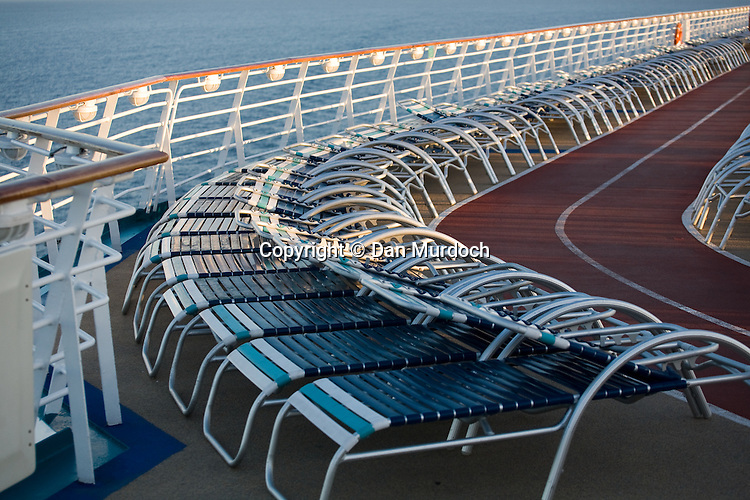 "Deck chairs on the Royal Caribbean cruise ship ""Explorer of the Seas""."