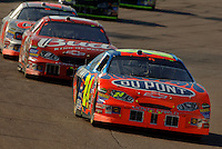 Nov 13, 2005; Phoenix, Ariz, USA;  Nascar Nextel Cup driver Jeff Gordon driver of the #24 Dupont Chevy leads Dale Earnhardt Jr. during the Checker Auto Parts 500 at Phoenix International Raceway. Mandatory Credit: Photo By Mark J. Rebilas.