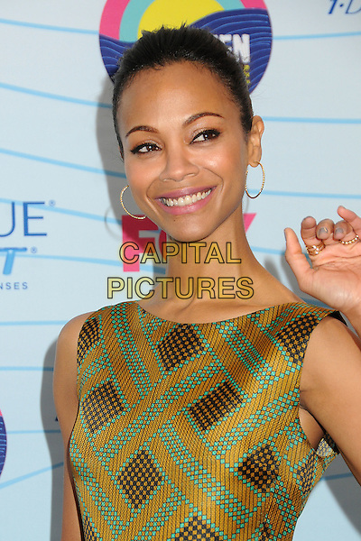 Zoe Saldana.Teen Choice Awards 2012 - Press Room held at Gibson Amphitheatre, Universal City, California, USA..July 22nd, 2012.headshot portrait brown yellow gold green sleeveless print hoop earrings.CAP/ADM/BP.©Byron Purvis/AdMedia/Capital Pictures.