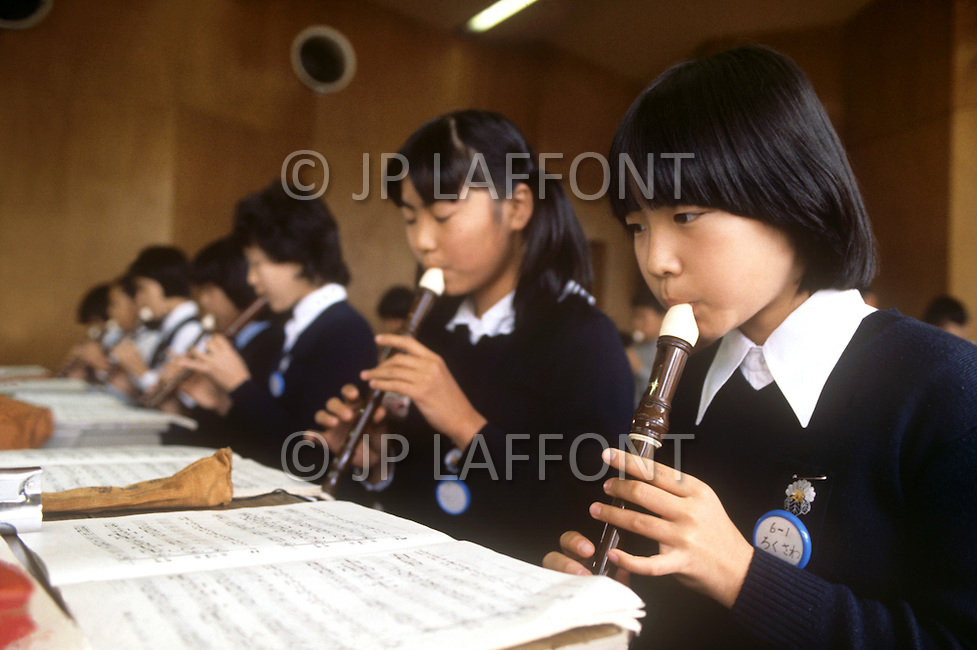 October, 1980. Tokyo, Japan. The students of the University of Chuo, Daigaku, in Tokyo, dilligently learn science, mathematics, art, music and other subjects throughout the educational process. The School of Music is sponsored by Yamaha.