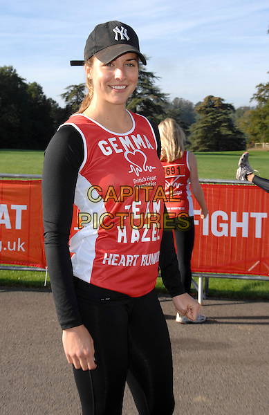 Gemma Atkinson<br /> British Heart Foundation 10k run at Blenheim Palace, Woodstock, Oxfordshire, England.<br /> 6th October 2013<br /> half length red top black baseball cap hat  <br /> CAP/PP/GM<br /> &copy;Gary Mitchell/PP/Capital Pictures