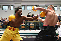 Adrian Redman (yellow shorts) defeats Harry Matthews during a Boxing Show at York Hall on 8th June 2019