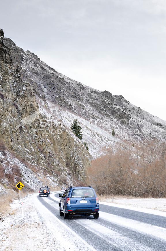 Cars driving through freshly fallen snow, Central Otago, South Island
