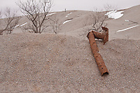 """""""Chat"""" the waste product of lead and zinc mining has left over 75 million tons of ground rock contaminated with lead and iron surrounding the town of Picher Oklahoma. Picher is considered the most toxic site in the US was the top priority for the Tar Creek Superfund.  The EPA has declared Picher to be one of the most toxic areas in the United States, and beyond being able to be cleaned up.  A government buyout, and a devastating tornado in 1998 turned a once thriving mining town into a ghost town almost overnight.  Picher ceased to exist offically as a town on Sept. 1, 2009."""