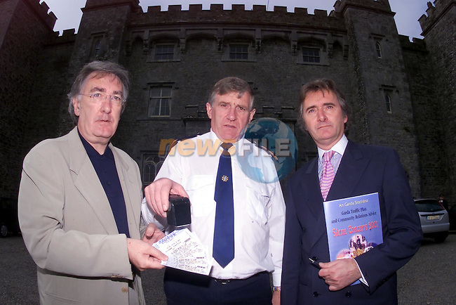 Chief Supt. Mick Finnegan holding one of the scanners that will be in use during the concerts to check fake tickets with Tommy Higgins of Ticketmaster and Lord henry Mountcharles oat the Press conference in Slane castle...Picture Fran Caffrey Newsfile.