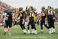 September 6, 2010; Hamilton, ON, CAN; Hamilton Tiger-Cats running back DeAndra' Cobb (14) celebrates his touchdown with teammates. CFL football: Labour Day Classic - Toronto Argonauts vs. Hamilton Tiger-Cats at Ivor Wynne Stadium. The Tiger-Cats defeated the Argonauts 28-13. Mandatory Credit: Ron Scheffler.