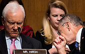 UNITED STATES - SEPTEMBER 27: Sen. Orrin Hatch, R-Utah, left, listens to testimony from Christine Blasey Ford as chairman Chuck Grassley, R-Iowa, speaks with staff during the Senate Judiciary Committee hearing on the nomination of Brett M. Kavanaugh to be an associate justice of the Supreme Court of the United States, focusing on allegations of sexual assault by Kavanaugh against Christine Blasey Ford in the early 1980s. (Photo By Tom Williams/CQ Roll Call/POOL)