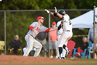 Ball State Cardinals first baseman Brandon Estep (15) tags Michael Ketchmark (27) during a game against the Dartmouth Big Green on March 7, 2015 at North Charlotte Regional Park in Port Charlotte, Florida.  Ball State defeated Dartmouth 7-4.  (Mike Janes/Four Seam Images)