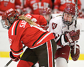Kelly Sabatine (St. Lawrence - 16), Alisa Baumgartner (Harvard - 27) - The Harvard University Crimson defeated the St. Lawrence University Saints 8-3 (EN) to win their ECAC Quarterfinals on Saturday, February 26, 2011, at Bright Hockey Center in Cambridge, Massachusetts.