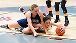 NAUGATUCK,  CT-011820JS03- Naugatuck's Kaylee Jackson (12) and Shepaug's Abigail Harty (40) hit the floor for a loose ball during their non-league game Saturday at Naugatuck High School. <br /> Jim Shannon Republican-American