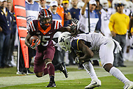 Landover, MD - September 3, 2017: Virginia Tech Hokies wide receiver Sean Savoy (15) stiff arms a West Virginia Mountaineers defender during game between Virginia Tech and WVA at  FedEx Field in Landover, MD.  (Photo by Elliott Brown/Media Images International)
