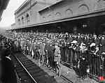 Crowds lined up at the old train station for the send-off of World War I draftees, circa 1917.