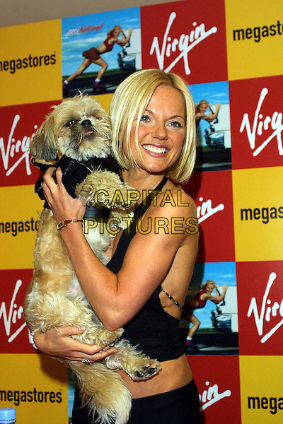 "GERI HALLIWELL  .at Virgin megastore in Piccadilly promoting her new album ""Scream If You Want To Go Faster"".www.capitalpictures.com.sales@capitalpictures.com.© Capital Pictures.boob tape, dog, animal, tit-tape"