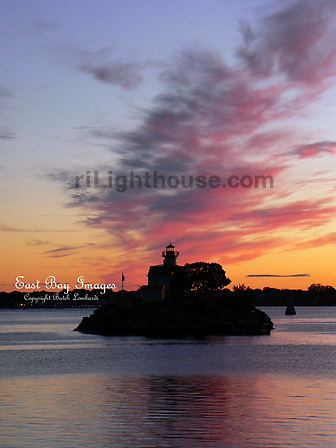 Ponham Rocks Lighthouse is silhouetted during this fiery spring sunset.