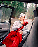USA, California, Yosemite National Park, a young woman prepares to go hiking in the rain