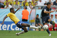 Brazilian defender (4) tries to tackle the ball away from Australian forward (15) John Aloisi. Brazil defeated Australia 2-0 in their FIFA World Cup Group F match at the FIFA World Cup Stadium, Munich, Germany, June 18, 2006.
