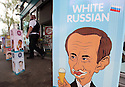 A Police officers walks past an eat ice cream advert using a cartoon of Russian President Vladimir Putin, at a petrol station close to the G8 Summit in Lough Erne, Northern Ireland, Britain, 18 June 2013. Leaders from Canada, France, Germany, Italy, Japan, Russia, USA and UK are meeting at Lough Erne in Northern Ireland for the G8 Summit 17-18 June. The leaders were holding their second and final day of talks on 18 June, with the global economy and tax avoidance high on the agenda.  Photo/Paul McErlane