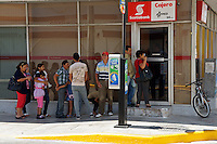 Mexican people lined up to use the atm outside a bank in Merida, Yucatan, Mexico...
