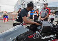 Apr. 5, 2013; Las Vegas, NV, USA: NHRA top fuel dragster driver Antron Brown greets Steve Torrence during qualifying for the Summitracing.com Nationals at the Strip at Las Vegas Motor Speedway. Mandatory Credit: Mark J. Rebilas-