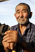 Margy Natpiool, 76, head of the Natpiool family home in Chodura, poses for a portrait at home in the taiga in Tuva Republic, Russia