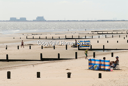 St Marys Bay Kent looking westward towards Littlestone-on-Sea. UK Dungeness Power Station in distance