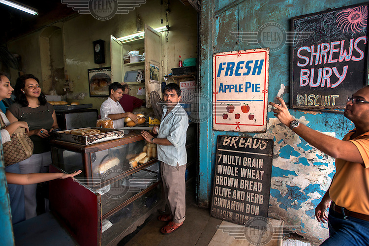 Customers buying bread at the Yazdani Restaurant and Bakery. The menu and decor of this 'Irani cafe' and Persian style bakery have hardly changed since it opened in 1953.