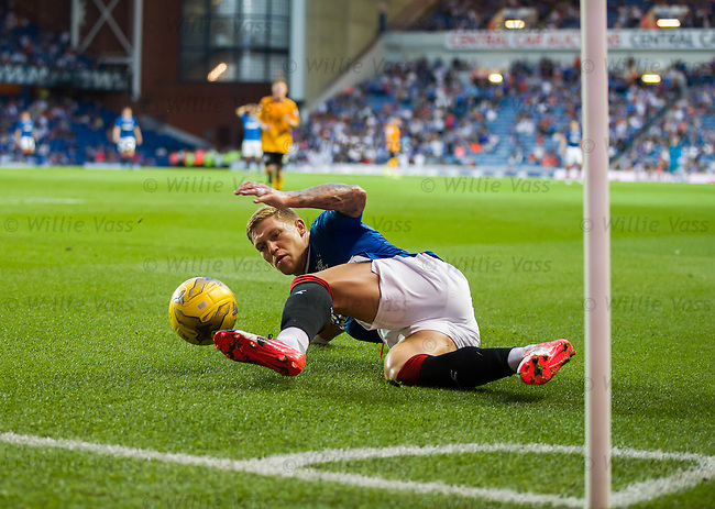 Martyn Waghorn slides to keep the ball in play at the corner flag