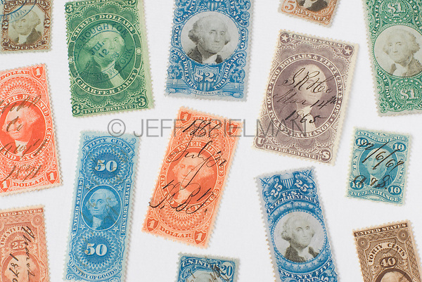 AVAILABLE FOR COMMERCIAL OR EDITORIAL LICENSING FROM GETTY IMAGES.  Please go to www.gettyimages.com and search for image # 173083835.<br /> <br /> Antique United States Revenue Stamps (Tax Stamps) issued by the U.S. government between the years 1862 and 1872.  These stamps, featuring a portrait of President George Washington, were used on documents and other paper items during the Civil War and in the following decade to show proof of payment of federal taxes.