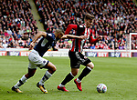 James Meredith of Millwall brings down Lee Evans of Sheffield Utd during the championship match at the Bramall Lane Stadium, Sheffield. Picture date 14th April 2018. Picture credit should read: Simon Bellis/Sportimage