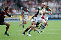 George Robson of Harlequins charges in midfield during the Aviva Premiership semi final match between Saracens and Harlequins at Allianz Park on Saturday 17th May 2014 (Photo by Rob Munro)