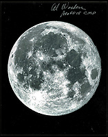 BNPS.co.uk (01202 558833)<br /> Pic: RRAuctions/BNPS<br /> <br /> A picture of the moon signed by astronaut Al Worden, Command Module Pilot of the Apollo 15 mission.<br /> <br /> A giant piece of the moon has emerged for sale for an astronomical &pound;380,000. ($500,000)<br /> <br /> The 12lb lunar meteorite is comprised of six fragments which can be pieced together like a jigsaw.<br /> <br /> The rock, unofficially known as 'The Moon Puzzle', was discovered last year in the remote North West African desert.<br /> <br /> It is one of the largest meteorites to be offered for sale, with meteorite finds typically weighing a few hundred grams.