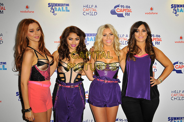 The Saturdays ( Una Healy, Vanessa White, Mollie King &amp; Frankie Sandford )<br /> The Capital FM Summertime Ball 2013, Wembley Stadium, Wembley, London, England.<br /> June 9th, 2013<br /> half length pink white purple corset top shorts trousers band group pregnant hand on hip<br /> CAP/MAR<br /> &copy; Martin Harris/Capital Pictures