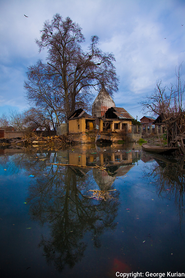 A ruined temple on the Dal lake across the cremation grounds of Kashmiri Pandits.
