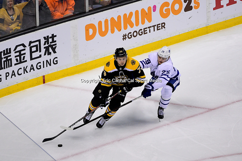 April 21, 2018: Toronto Maple Leafs center William Nylander (29) stick checks Boston Bruins defenseman Charlie McAvoy (73) during game five of the first round of the National Hockey League's Eastern Conference Stanley Cup playoffs between the Toronto Maple Leafs and the Boston Bruins held at TD Garden, in Boston, Mass. Toronto defeats Boston 4-3, Boston leads Toronto 3 games to 2 in the best of 7 series.