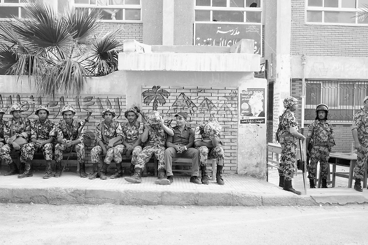 Egypt/ Suez / 23.5.2012 / Egyptian special forces sit outside a polling station in Suez during the first round of the presidential elections. May 23rd, 2012. Suez, Egypt.<br /> <br /> © Giulia Marchi