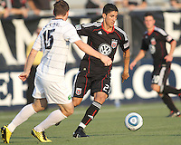 Pablo Hernandez #21 of D.C. United moves the ball away from JT Noone #15 of the Harrisburg City Islanders during a US Open Cup match at the Maryland Soccerplex on July 21 2010, in Boyds, Maryland. United won 2-0.