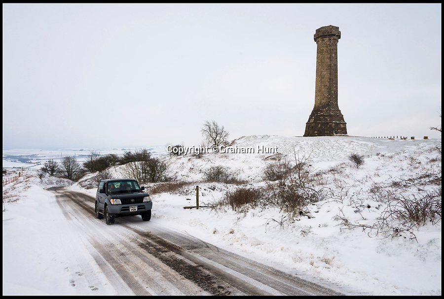 BNPS.co.uk (01202 558833)<br /> Pic: Graham Hunt/BNPS<br /> <br /> Icy roads at a wintery Hardy's Monument on Blackdown near Portesham after heavy overnight snow covered southern Britain.<br /> <br /> A 4x4 on the narrow lane which passes close to the monument.