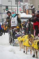 Colleen Robertia leaves the 2011 Iditarod ceremonial start line in downtown Anchorage, during the 2012 Iditarod..Jim R. Kohl/Iditarodphotos.com