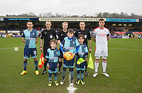 Match day  Mascots line up with Referee Gavin Ward his officials and captains Matt Bloomfield of Wycombe Wanderers & Jimmy Smith of Crawley Town ahead of the Sky Bet League 2 match between Wycombe Wanderers and Crawley Town at Adams Park, High Wycombe, England on 25 February 2017. Photo by Andy Rowland / PRiME Media Images.