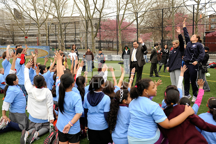 Students ask questions of Allie Long and Kendall Fletcher during a Women's Professional Soccer (WPS) soccer clinic PS 192 in Harlem, NY, on April 7, 2011.