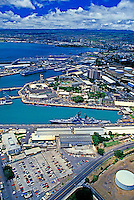 Impressive aerial shot of Pearl Harbor with grey destroyer in foreground.