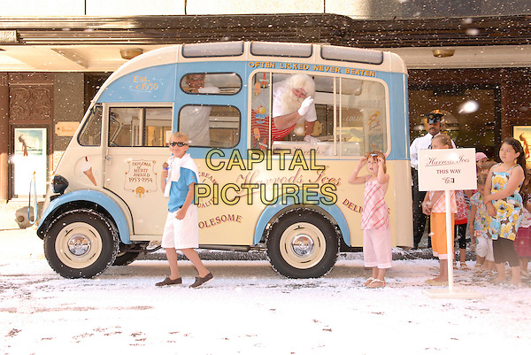"FATHER CHRISTMAS.The opening of ""Christmas World"" at Harrods, Knightsbridge, London, England, 7th August 2007..ice-cream ice cream van kids children snow xmas santa claus.CAP/FIN.©Steve Finn/Capital Pictures."