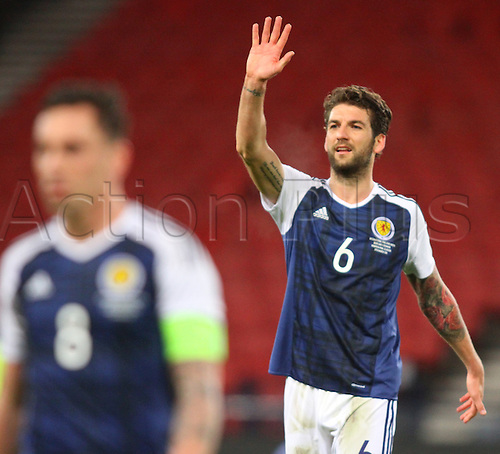 29.03.2016. Hampden Park, Glasgow, Scotland. International Football Friendly Scotland versus Denmark. Charlie Mulgrew waves to his family in the stand after the match