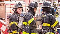 Members of Rescue Company 2 after operating at a three alarm fire at 180 East 18 Street in Prospect Park South, Brooklyn