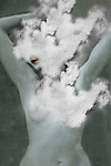 Conceptual image of naked female with head in clouds