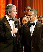 Washington, D.C. - February 6, 2006 -- United States President George W. Bush and Arthur Mitchell following the performance in the East Room of the White House honoring the Dance Theatre of Harlem and Mr. Mitchell, its Founder and Artistic Director, in Washington, D.C. on February 6, 2006. <br /> Credit: Ron Sachs / CNP