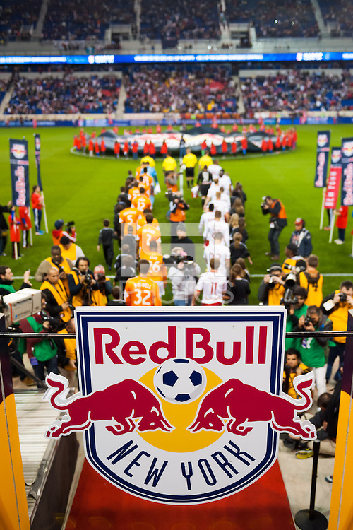 The Houston Dynamo and the New York Red Bulls enter the field of play prior to the start of the match. The The Houston Dynamo defeated the New York Red Bulls 2-1 (4-3 on aggregate) in overtime of the second leg of the Major League Soccer (MLS) Eastern Conference Semifinals at Red Bull Arena in Harrison, NJ, on November 6, 2013.