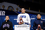 CLEVELAND, OH - MARCH 10: Jay Albis, of Johnson & Wales, stands atop the podium after winning first place in the 125 weight class during the Division III Men's Wrestling Championship held at the Cleveland Public Auditorium on March 10, 2018 in Cleveland, Ohio. Albis is joined on the podium by second place winner, Carlos Fuentes of Wheaton and third place winner, Mike Totorice of Wisconsin-Whitewater.  (Photo by Jay LaPrete/NCAA Photos via Getty Images)
