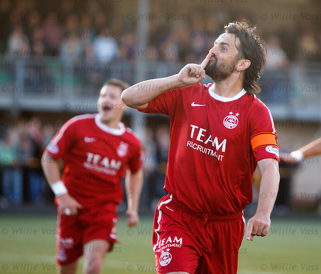 Aberdeen's Paul Hartley scores from the penalty spot and celebrates to the Alloa fans with his finger to his mouth