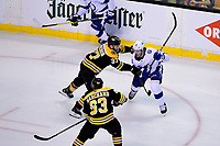 May 2, 2018: Boston Bruins center Patrice Bergeron (37) checks Tampa Bay Lightning center J.T. Miller (10) during game three of the second round of the National Hockey League's Eastern Conference Stanley Cup playoffs between the Tampa Bay Lightning and the Boston Bruins held at TD Garden, in Boston, Mass. Tampa Bay defeats Boston 4-1. Eric Canha/CSM
